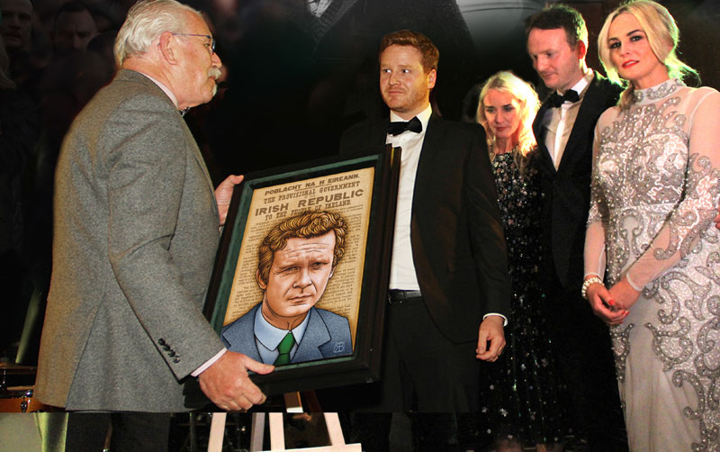 Family of Martin McGuinness receiving portrait